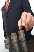 Uomo d'affari con monete — Foto Stock