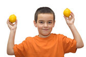 Boy with lemons — 图库照片