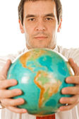 Buainessman holding the globe — Stock Photo