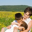Family in the grass — Stock Photo #10717081