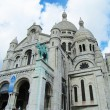 Basilica of Montmartre in a cloudy day - Stock Photo