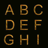 Gold Alphabet text — Stock Photo