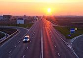 Highway at sunrise — Stock Photo