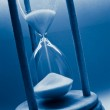 Hourglass in blue — Stock Photo