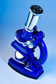 Microscope in blue light — Stock Photo