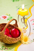 Red eggs and candle — Stock Photo