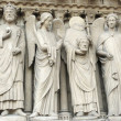 Saints and angels from Notre Dame de Paris — Stock Photo