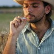 Stock Photo: Smoking Cowboy