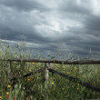 Wooden Fence with Stormy Sky - Stock Photo