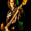Rock Woman Playing Electric Bass Guitar — Stock Photo #10801287