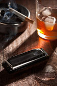 Harmonica with Whiskey and Cigarette — Stock Photo