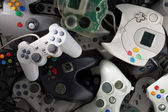 Scattered Videogames Gamepads — Stock Photo