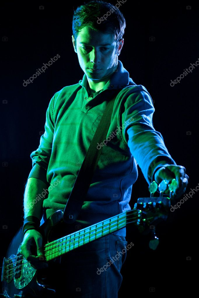 Bassist Tuning His Bass During a Concert — Stock Photo #10801182