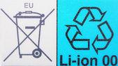 Emblems on an accumulator — Stock Photo