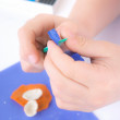 A child models plasticine - Stock Photo