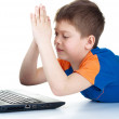 Child plays with notebook — Stock Photo #10488343