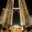 Petronas Twin Towers in Kuala Lumpur at night - Stock Photo