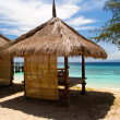 Hut at beach and turquoise sea on island, Gili Islands - Stock Photo