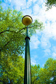 High beautiful lantern in the garden — Stock Photo