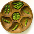 Peas in vintage wooden bowl — Stock Photo