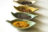 Spices in leaf shaped fancy bowls — Stock Photo