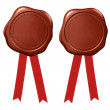 Wax seal with red ribbons — Stock Photo