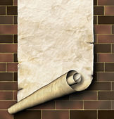 Antique paper scroll on the brick wall — Stock Photo