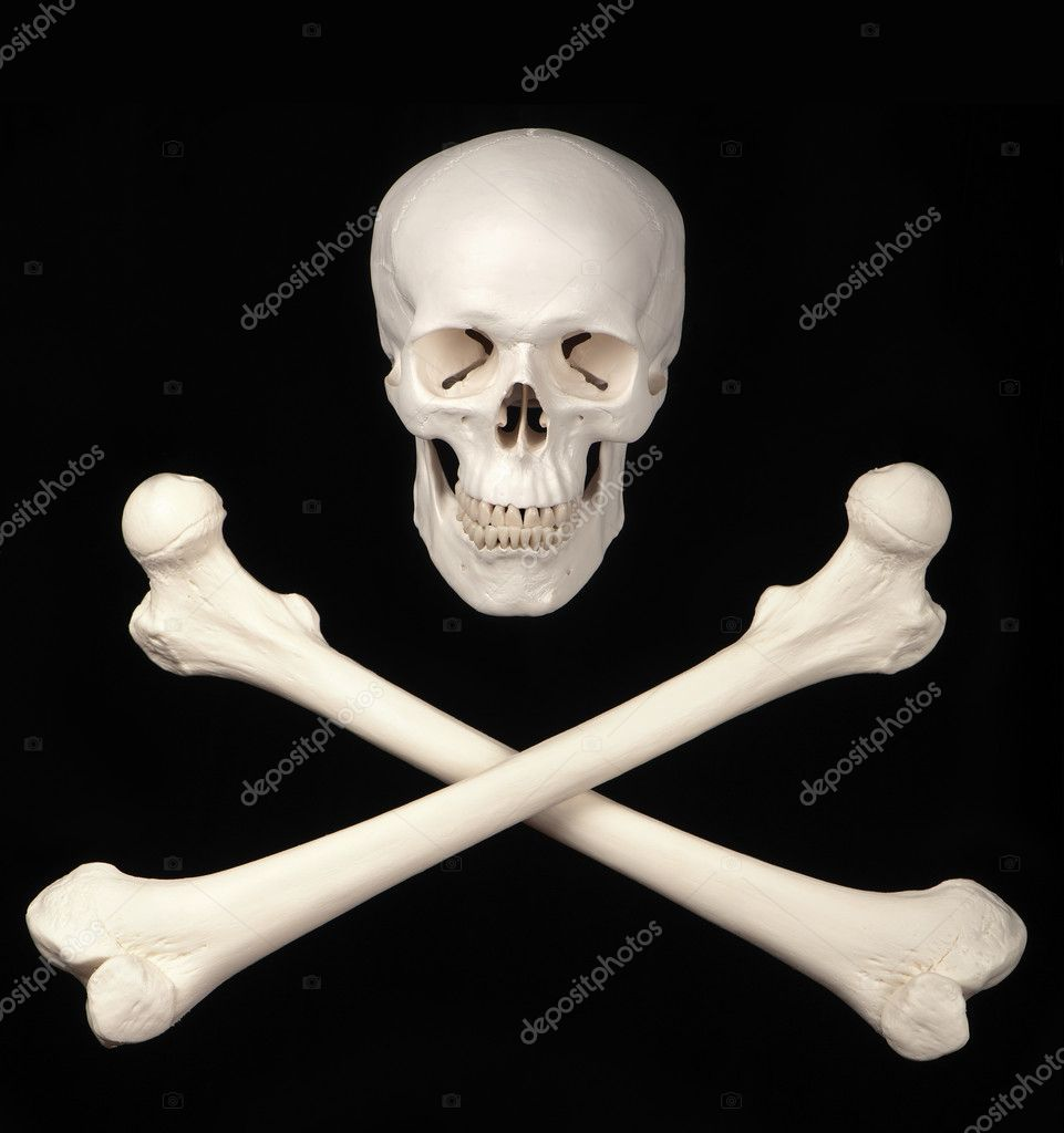 A skull and crossbones against a black background symbolize danger. — Stock Photo #10490738