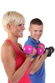 Attractive woman with her personal fitness trainner — Stock Photo