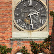 Stock Photo: Clock on wall of building