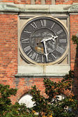 Clock on the wall of the building — Stock Photo