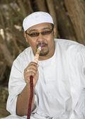 Muslim smoking hookah — Stock Photo