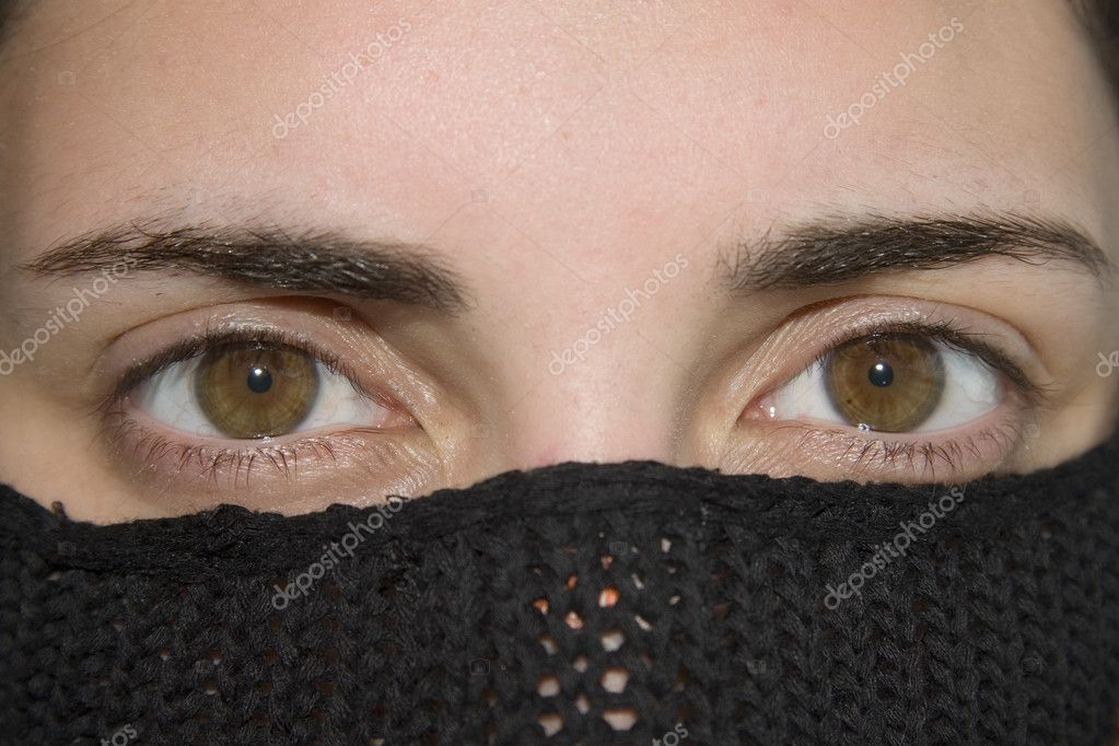 The eyes of a girl with black headscarf, in Arab style  Stock Photo #10645824