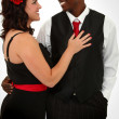 Beautiful Interacial Couple Husband and Wife Dancing - Stock Photo