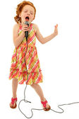 Adorable Child Singing into Microphone — Stok fotoğraf