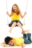 School Girl on Swing Knocks Boy Down on Ground — Zdjęcie stockowe