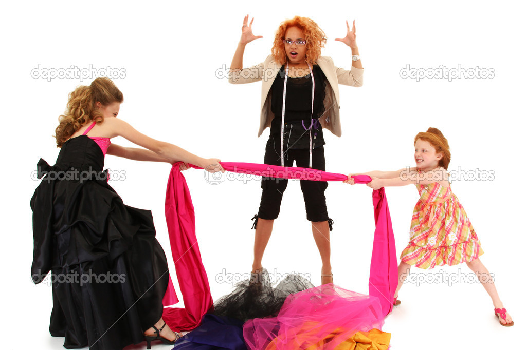 Two beautiful angry spoiled pageant girls fighting over fabric for dress design over white.  Stock Photo #10553796