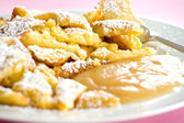 Austrian sweet dessert called kaiserschmarrn with apple sauce — Stock Photo