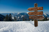 Panorama of the alps with a wooden sign — Stock Photo