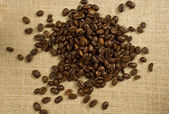 Coffee beans on burlap — Stock Photo