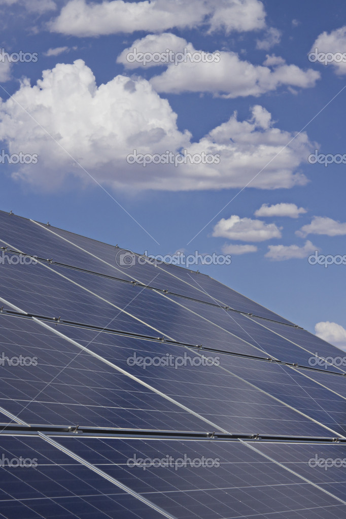 Solar Panels with blue sky and white clouds. — Stock Photo #10562032