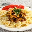 Farfalle with chicken fillet and mushrooms stew - Stock Photo