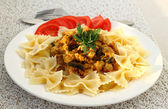 Farfalle with chicken fillet and mushrooms stew — Stock Photo