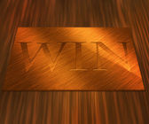 Win on Golden Plate Background — Stock Photo