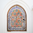 An ornate arch window with flowery islamic motif — Stock Photo