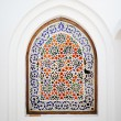 Stock Photo: Ornate arch window with flowery islamic motif