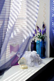Bouquet of fresh flowers on window — Stock Photo