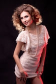 A woman in a beige dress — Stock Photo