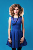 A woman in a blue dress — Stock Photo