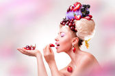 A cute woman with a fruits — Stock Photo